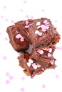 Brownie slices of a covered with chocolate and decorated with sugar hearts Royalty Free Stock Photography
