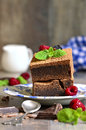 Brownies decorated with raspberry and mint leaf on rustic background Royalty Free Stock Photography