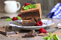 Brownies decorated with raspberry and mint leaf on rustic background Royalty Free Stock Images