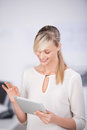 Browsing on tablet long hair female the internet through digital Royalty Free Stock Photo
