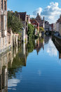 Bruges belgium europe september buildings alongside a ca canal in west flanders in on unidentified people Royalty Free Stock Images