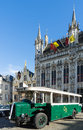 Bruges belgium europe september old bus outside the prov provincial palace in market square west flanders on Royalty Free Stock Images