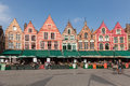 BRUGES, BELGIUM - MARCH 23, 2015. Tourists in north side of Grote Markt (Market Square) of Bruges, Brugge, with enchanting street Royalty Free Stock Photo