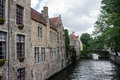 Bruges canal belgium the typical stone houses and a bridge over a in Royalty Free Stock Photos
