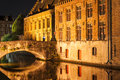 Bruges canal by night in flanders belgium at unrecognizable person is taking a photograph using flash Stock Photography