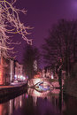 Bruges canal a in at night with illuminated bridges tone radiant orchid Royalty Free Stock Image