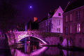 Bruges canal a in at night with illuminated bridges tone radiant orchid Stock Images