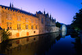 Bruges canal by night a reflects the buildings and belfry of the historic old city of Stock Image