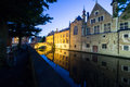 Bruges canal by night a reflects the buildings and belfry of the historic old city of Royalty Free Stock Images