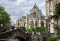 Bruges cathedral belgium the back of and a bridge with tourists Royalty Free Stock Images
