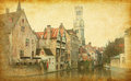 Bruges historic centre the classic view from the rozenhoedkaai belgium photo in retro style added paper texture Royalty Free Stock Image