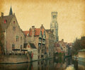 Bruges historic centre the classic view from the rozenhoedkaai belgium photo in retro style paper texture Royalty Free Stock Photos