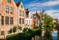 Bruges impressions of brickwall houses along a small river in the venice of the north in belgium Stock Photos
