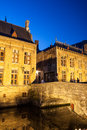 Bruges at night shot of historic medieval buildings along a canal in belgium Royalty Free Stock Photos