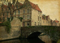 Bruges one of canals belgium photo in retro style added paper texture Stock Images
