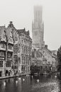 Bruges water canal and belfry tower in monochrome vintage belgium Royalty Free Stock Photography