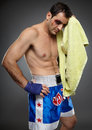 Bruised fighter with towel and injured after a difficult match Stock Photography