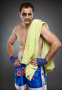 Bruised fighter with towel and injured after a difficult match Stock Photo