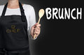 Brunch cook holding wooden spoon background Royalty Free Stock Image