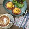 Brunch happy meal with egg benedict and hot latte for Royalty Free Stock Images