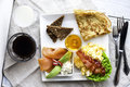 Brunch plate with eggs salmon bread and pancakes Royalty Free Stock Photo