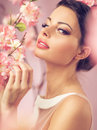 Brunette beautie with the flowers pink Stock Photos