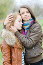 Brunette and blond haired girls friends hug Royalty Free Stock Photos