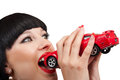 Brunette and a car close up of beautiful who wants to eating little red Stock Photos