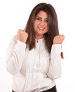 Brunette celebrating portrait of a victory in a white shirt against a neutral background woman girl emotion happiness Royalty Free Stock Photos
