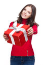 Brunette christmas beauty portrait of a holding shiny red gift box Royalty Free Stock Photos