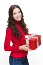Brunette christmas beauty portrait of a holding shiny red gift box Stock Photography