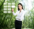 Brunette ecological businesswoman touch keypad Stock Image