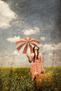 Brunette enchantress with umbrella and suitcase Royalty Free Stock Photo