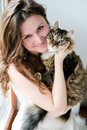 Brunette girl and her cat over beautiful smiling ginger Royalty Free Stock Photo