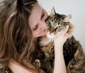 Brunette girl and her cat over beautiful smiling ginger Royalty Free Stock Photography