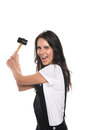 Brunette girl holding hammer and smiling at camera isolated on white Royalty Free Stock Photo