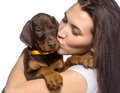 Brunette girl kissing her puppy isolated on white background doberman Royalty Free Stock Photography