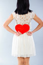 Brunette girl with red Valentine heart Royalty Free Stock Photography