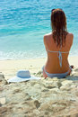 Brunette girl relaxing in water on the beach Royalty Free Stock Photo