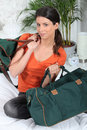 Brunette with hand luggage Royalty Free Stock Photography