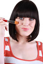 Brunette holding brush to her face young woman Stock Photos