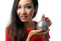 Brunette holding a christmas ball on white closeup portrait of one beautiful decoration studio background Royalty Free Stock Images