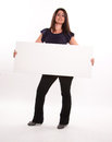 Brunette holding message board a blank Royalty Free Stock Photos