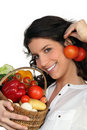 Brunette holding vegetables Stock Photos
