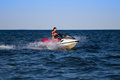Brunette on a jetski young in life jacket riding Royalty Free Stock Photography