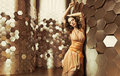 Brunette lady dancing in the shiny room woman Stock Image