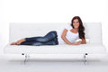 Brunette laid on sofa designer Stock Photos