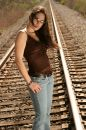 Brunette leaning back on tracks Stock Photos