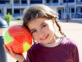 Brunette little girl football player and ball Royalty Free Stock Photo