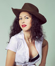 Brunette long hair girl have fun posing  in studio in cowboy sty Royalty Free Stock Photo